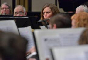 Flute player performing with Meridian Community Band